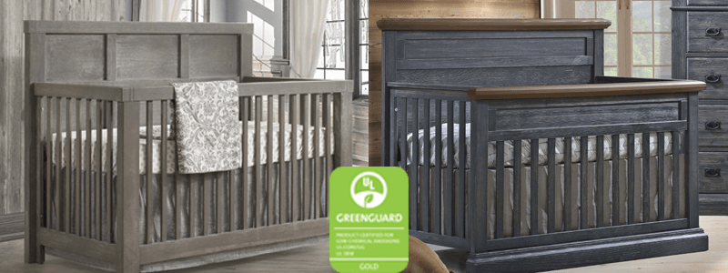 Two wooden rustic cribs in dark brown and black chalet with greenguard green logo